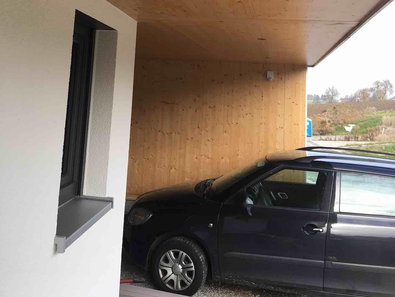Strobel Komplettbau -Einfamilienhaus /Ansicht überdachter Eingang mit Carport
